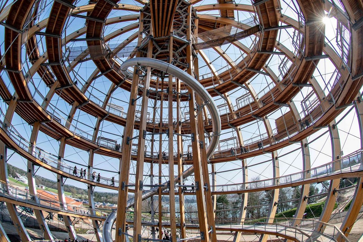"""A picture taken on April 1, 2019 shows a view of the """"Erlebnisholzkugel"""", a spherical wooden observation tower, during its inauguration in Steinberg am See, southern Germany. PHOTO: DPA VIA AFP"""