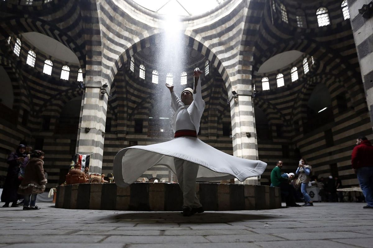 Dervish dancers performs during an event titled 'the Festival of the Syrian Bread held at Khan Asaad Basha in the old city of Damascus, Syria, on April 1, 2019 to commemorate the Syrian New Year according to the Syrian culture. PHOTO: EPA-EFE