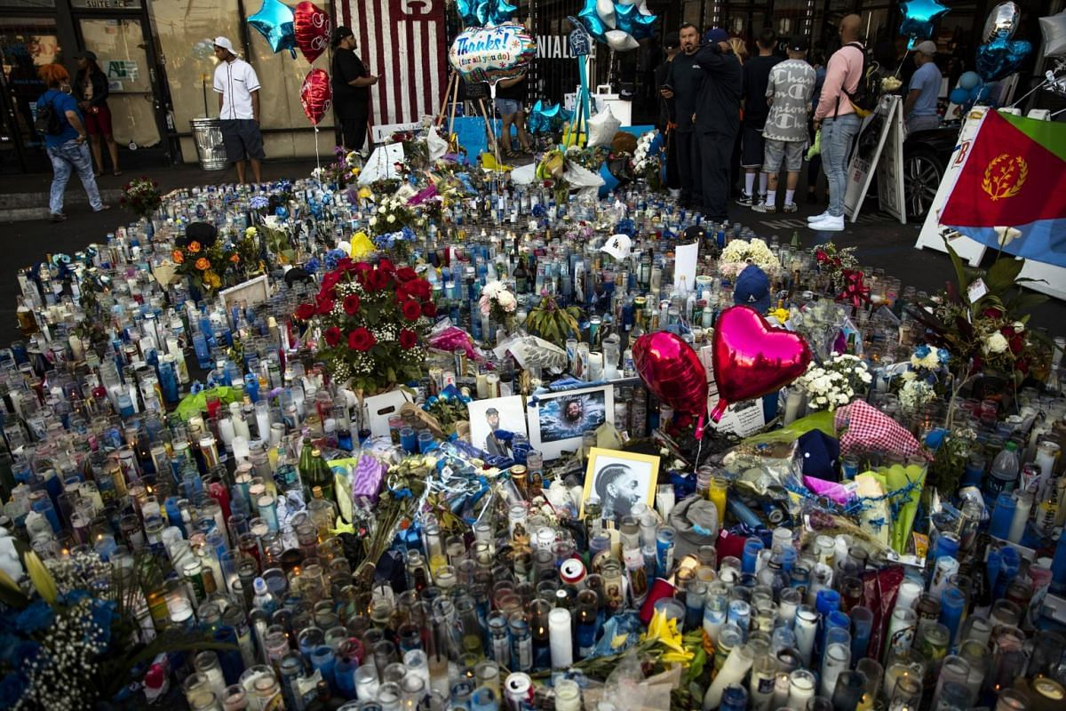 Candles, as well as photos and drawings of Nipsey Hussle, placed in front of the rapper's shop, where he died after getting shot, in Los Angeles, California, on April 2, 2019.