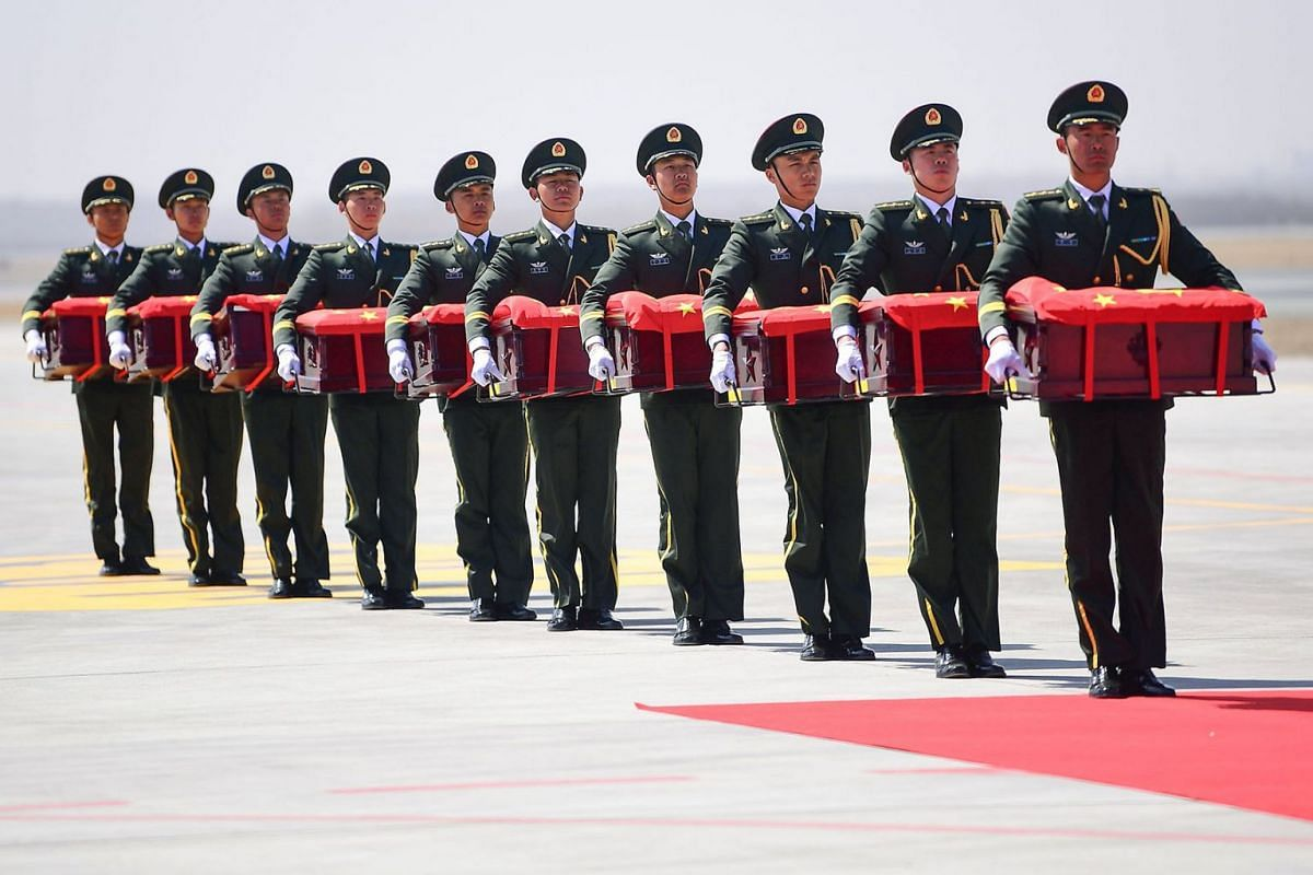 Chinese honour guards carry caskets containing the remains of Chinese soldiers at the Shenyang Taoxian International Airport in Shenyang in China's northeastern Liaoning province on April 3, 2019.  PHOTO: AFP