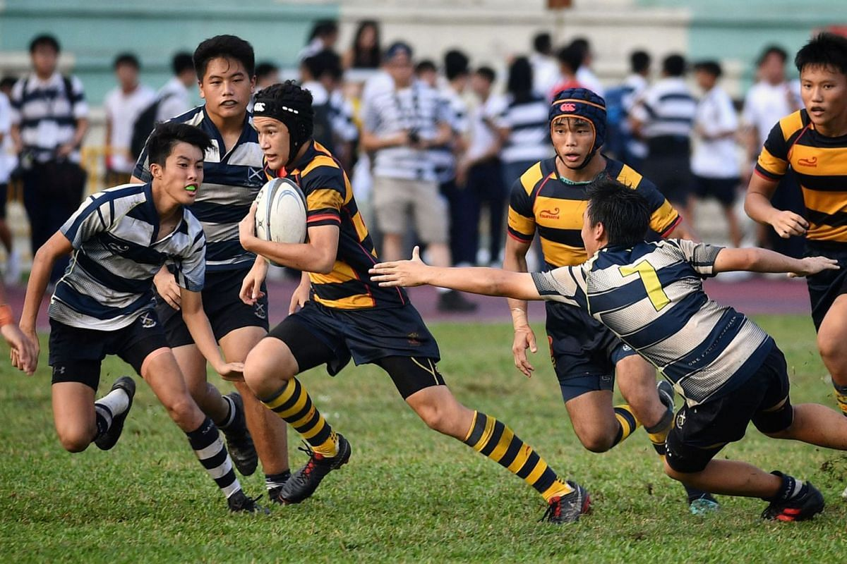 Anglo-Chinese School (Independent) players (in blue and yellow) recycled the ball from flank to flank before finding the gaps to beat St Andrew's Secondary School in the Schools National B Division rugby final at the Queenstown Stadium in Singapore
