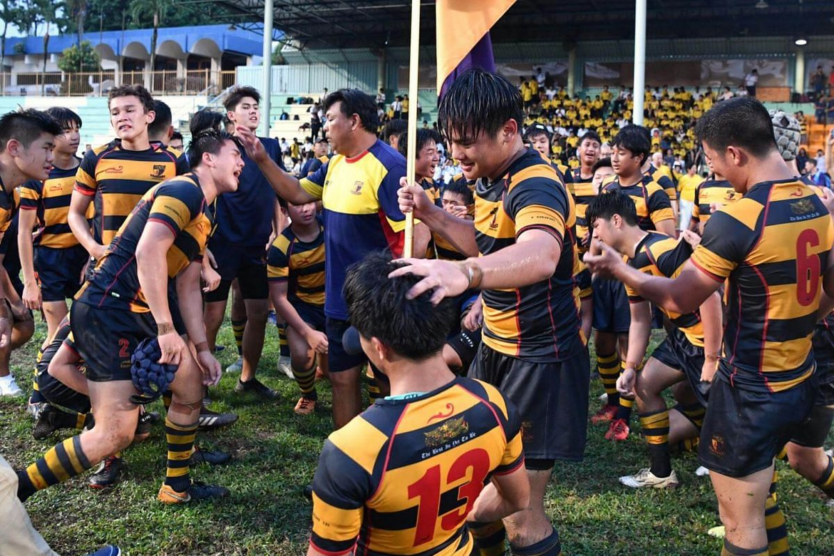 ACS(I) rugby players celebrate after beating St Andrew's in the B division Boys Rugby Final.