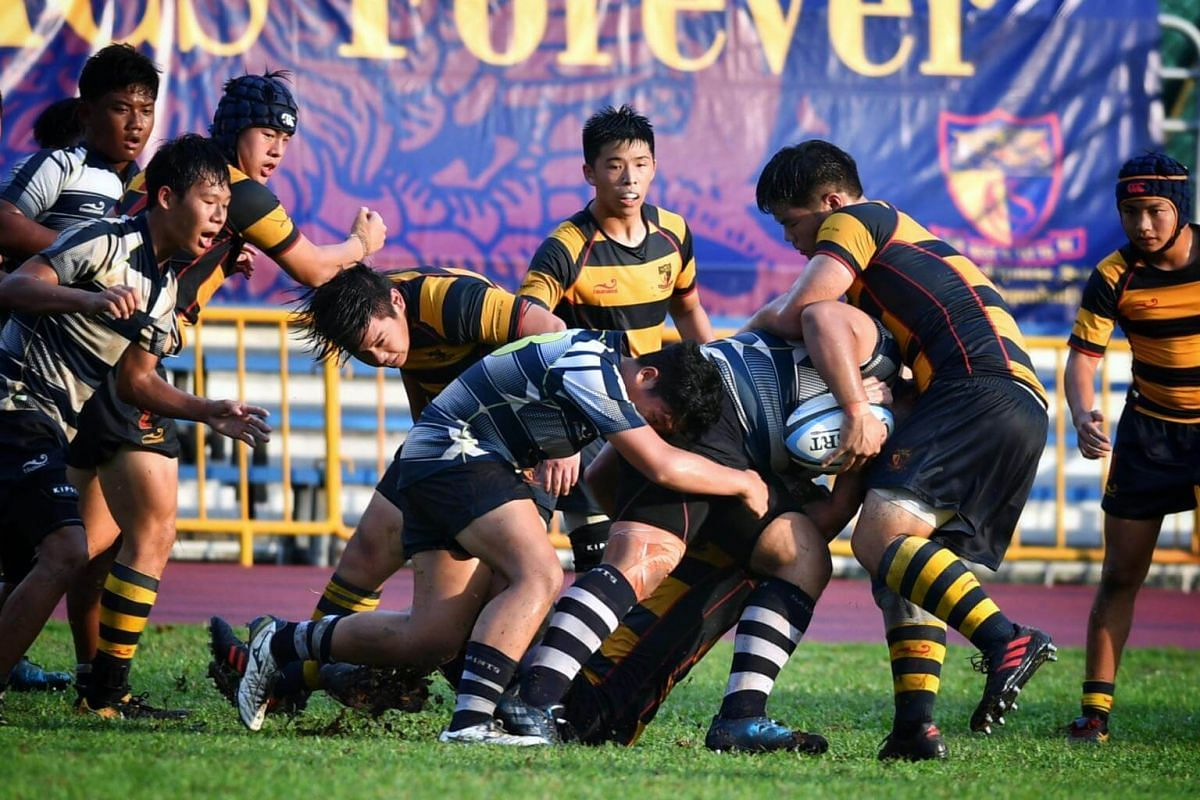 The St Andrew's rugby players trying to find a way through their opponents' defence in the B division Boys Rugby Final.