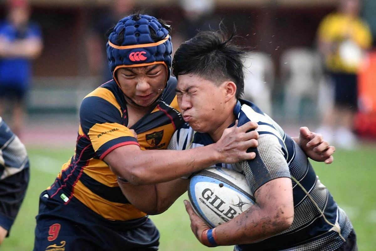 Iain Yeow Wei Han from ACS(I) (left) tackles Dillion Jordan Mack from St Andrew's during the B division Boys Rugby Final.