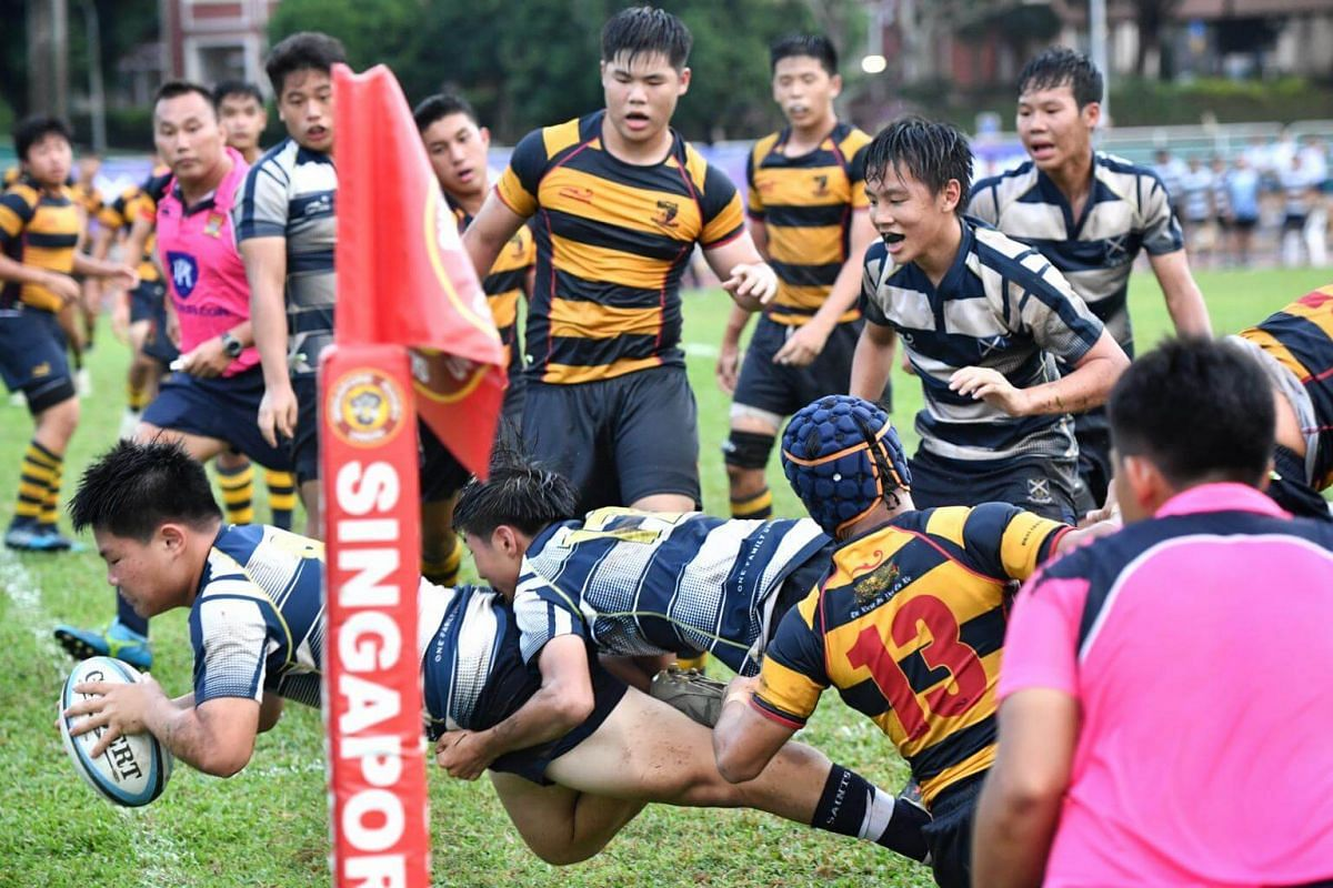 Elijah Jap (far left) scores a try for St Andrew's in the B division Boys Rugby Final.