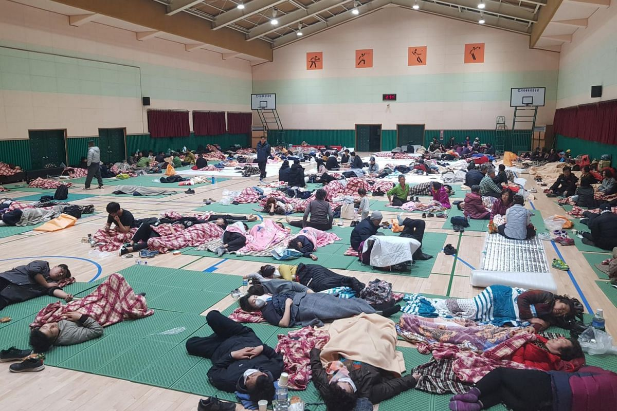 People rest at a temporary shelter during a wildfire in Sokcho, South Korea, on April 5, 2019.