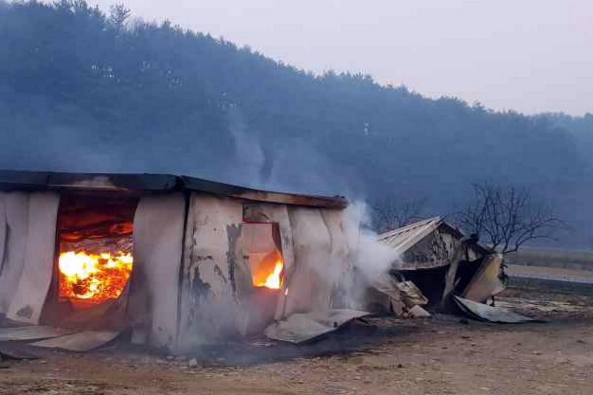 A house is still burning after a massive fire engulfed the area, in Gangneung, South Korea, on April 5, 2019.