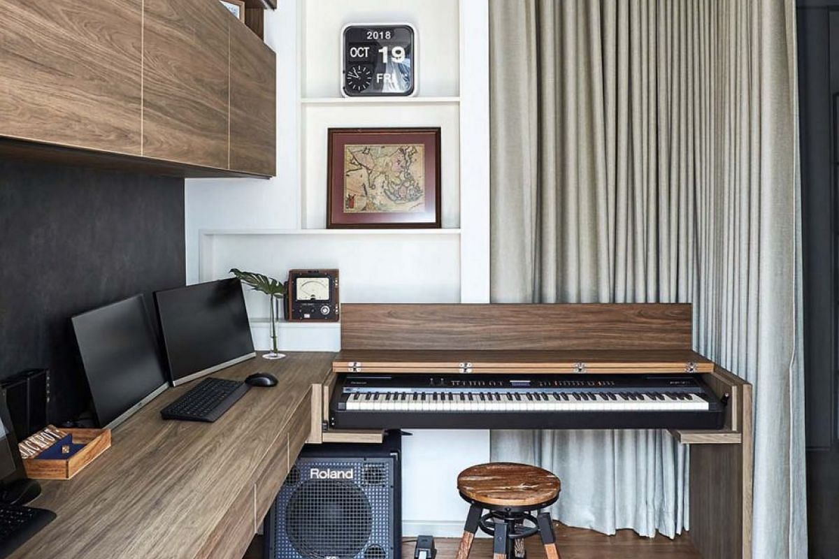 Carved out from the living area, the study boasts an earthy palette. It is where the home owner plays his keyboard, which has been integrated with his desk using a movable panel that, when lifted, activates the keyboard and amplifier without the need for