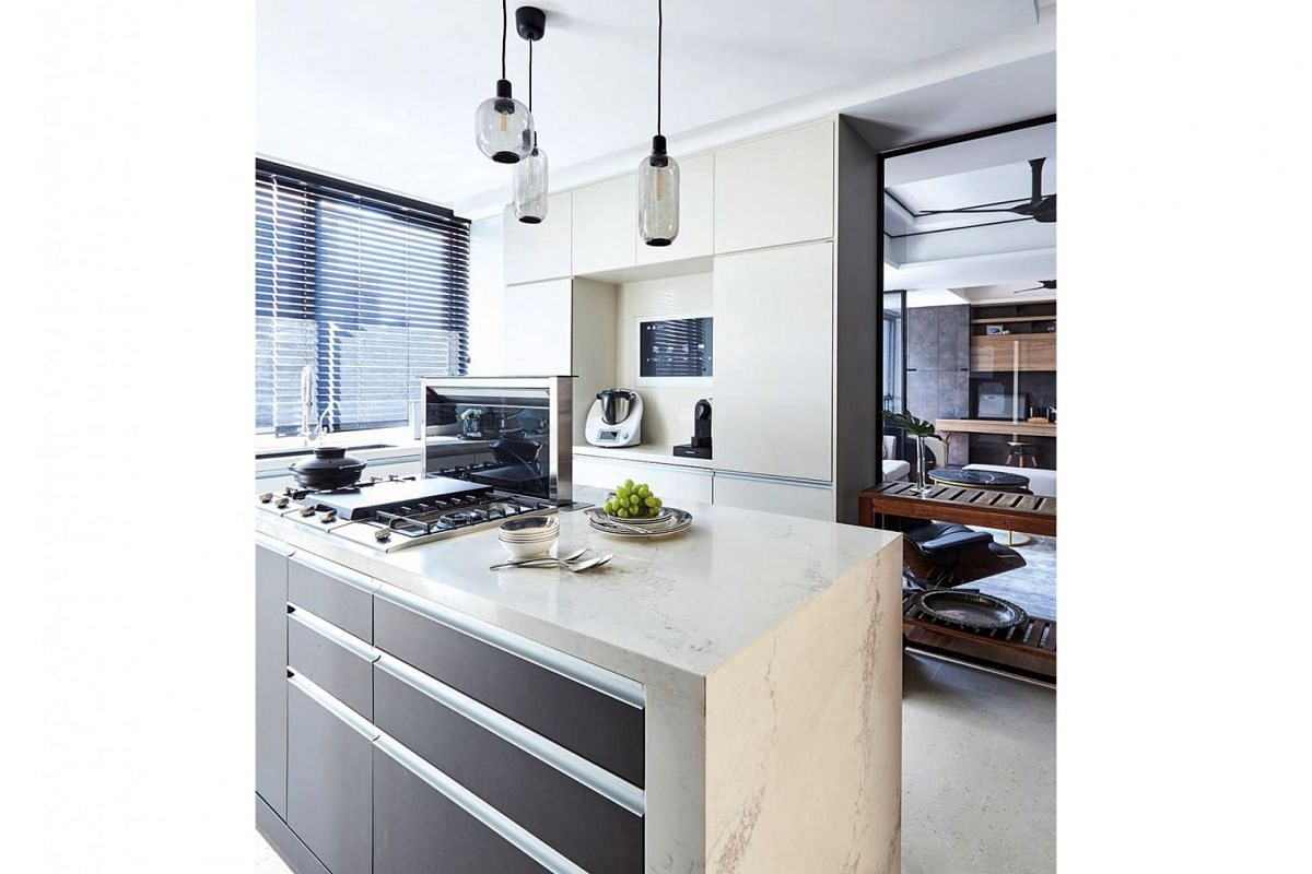 The kitchen island has been elevated slightly to accommodate the floor's uneven level.