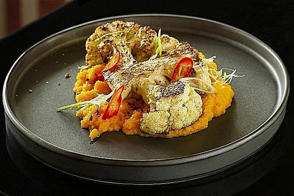Dishes at Jam at Siri House include ribeye served with kombu butter (far left), cauliflower with curried carrot mash (left) and cookies made with chicken fat (below).