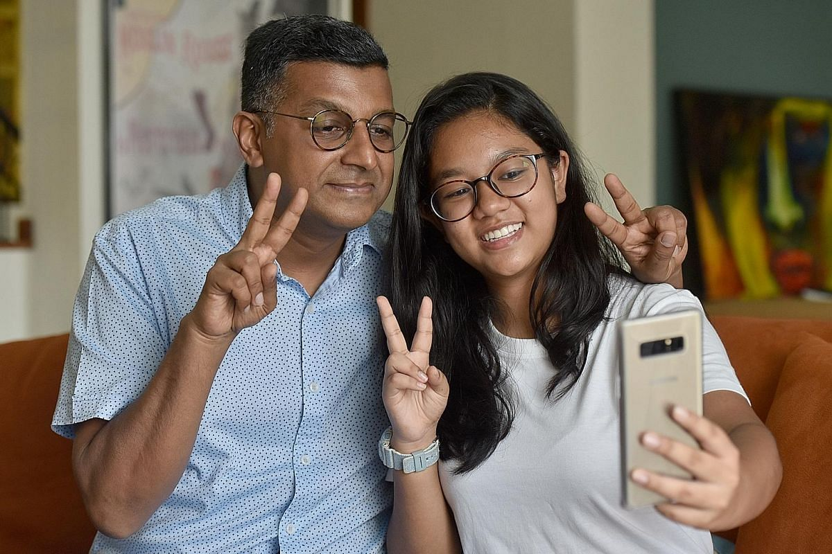 Mr Murugesh Nagaraju ensures his children, Tanisha Mei (left) and Trishen Kai, are okay with what he posts online. With the support of her children, stay-at-home mother Apple Teoh (left, with daughters Rebecca, centre, and Li-Ann) blogs and posts on