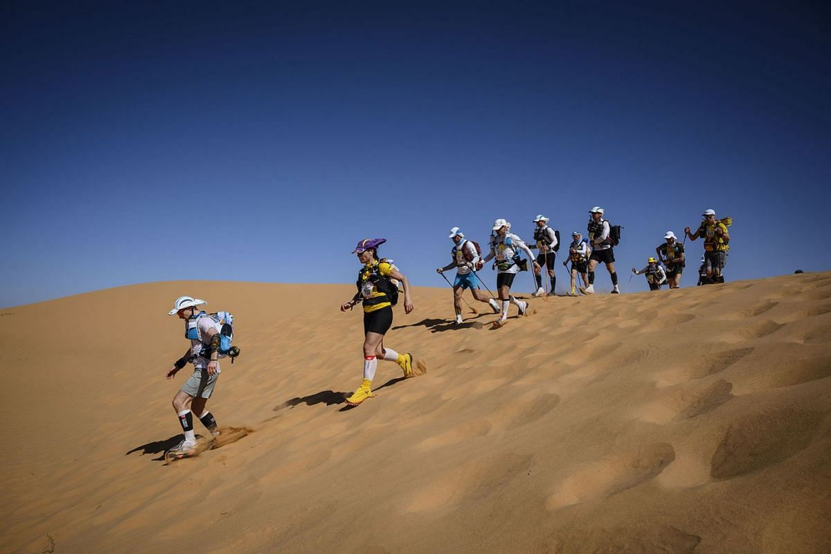 People compete in the stage 2 of the 34th edition of the Marathon des Sables between Tisserdimine and Kourci Dial Zaid in the southern Moroccan Sahara desert, on April 8, 2019. PHOTO: AFP