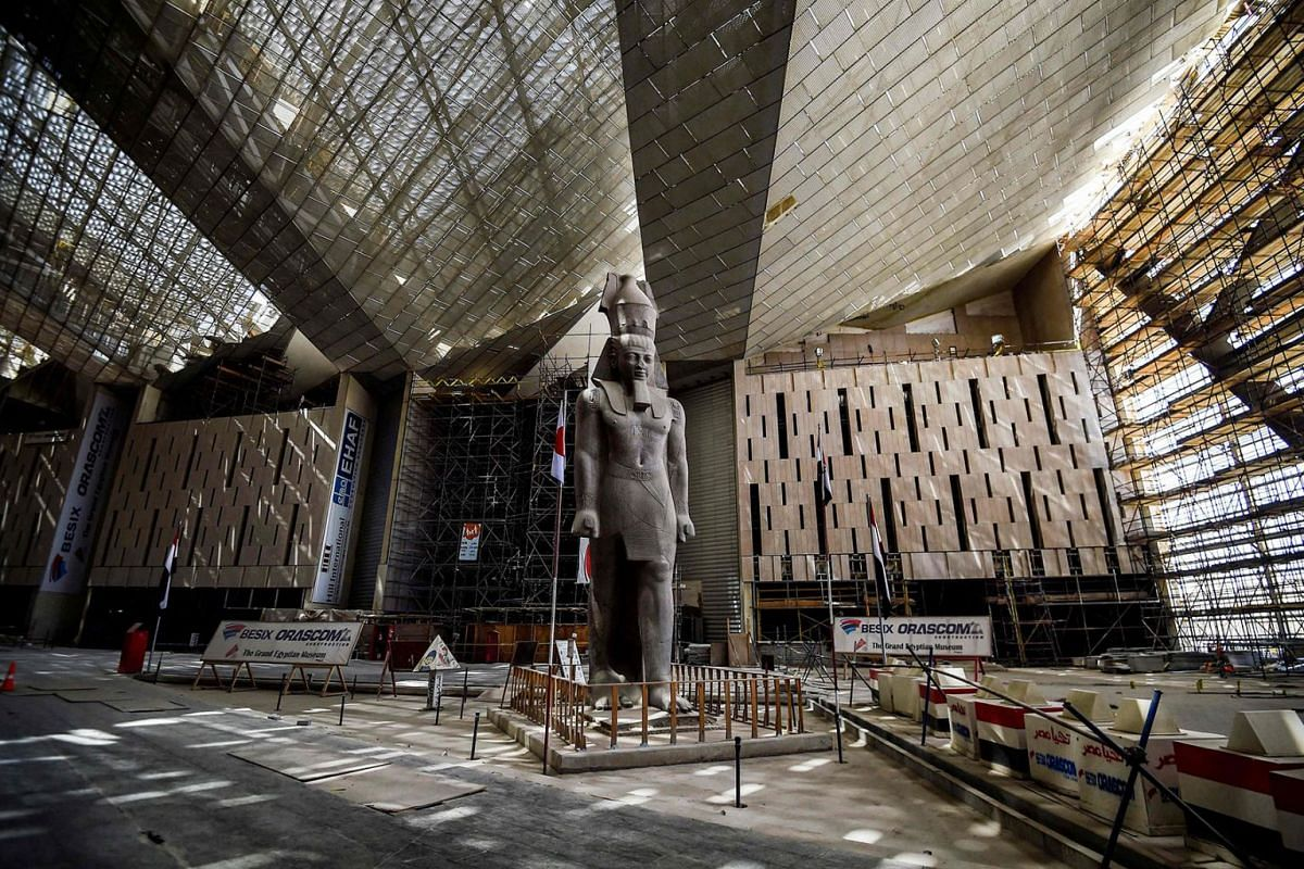 This picture taken on April 7, 2019 shows the colossus of ancient Egyptian Pharaoh Ramses II, at its permanent display spot in the newly-built Grand Egyptian Museum (GEM) in Giza on the southwestern outskirts of the capital Cairo. PHOTO: AFP
