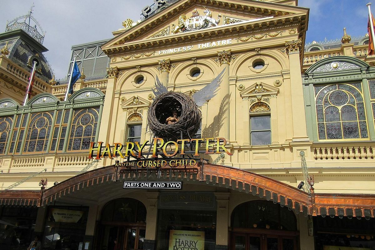 The facade of Melbourne's Princess Theatre features a sculpture of a winged nest holding a small child - the logo of the J.K. Rowling-approved production Harry Potter And The Cursed Child. (From left) Paula Arundell as Hermione Granger, Gyton Grantle