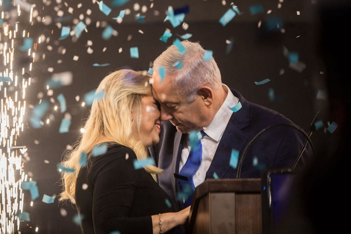 Israeli Prime Minister Benjamin Netanyahu (R) embraces his wife Sara before delivering a speech following the announcement of the exit polls of the Israeli parliamentary elections on April 10, 2019, Israel, Tel Aviv. PHOTO: DPA