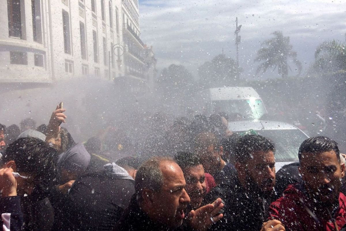 Police officers use water cannon to disperse people protesting after parliament appointed upper house chairman Abdelkader Bensalah as interim president following the resignation of Abdelaziz Bouteflika in Algiers, Algeria April 9, 2019. PHOTO: REUTER