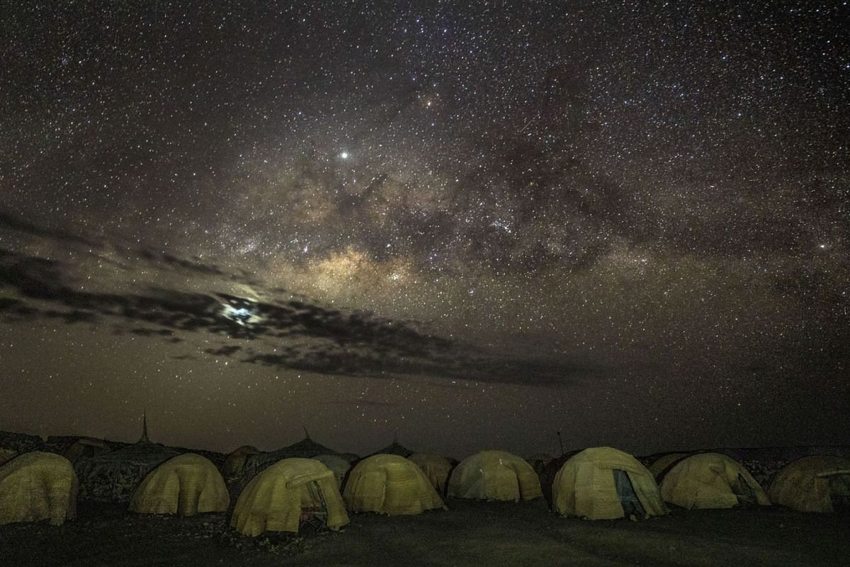 A photo issued on April 10, 2019 shows travelers taking shelter in dome tents at a campsite near Lake Abbé, Djibouti, Feb. 13, 2019. The area is a day's drive away from the new rail line that runs from Addis Ababa, Ethiopia, to Djibouti City on the