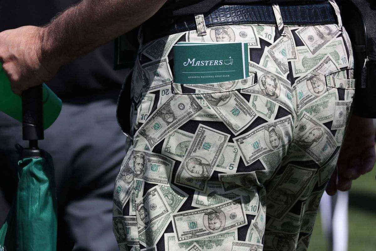 A patron wears money pants during the second day of practice for the 2019 Masters golf tournament at the Augusta National Golf Club in Augusta, Georgia, U.S., April 9, 2019. PHOTO: REUTERS