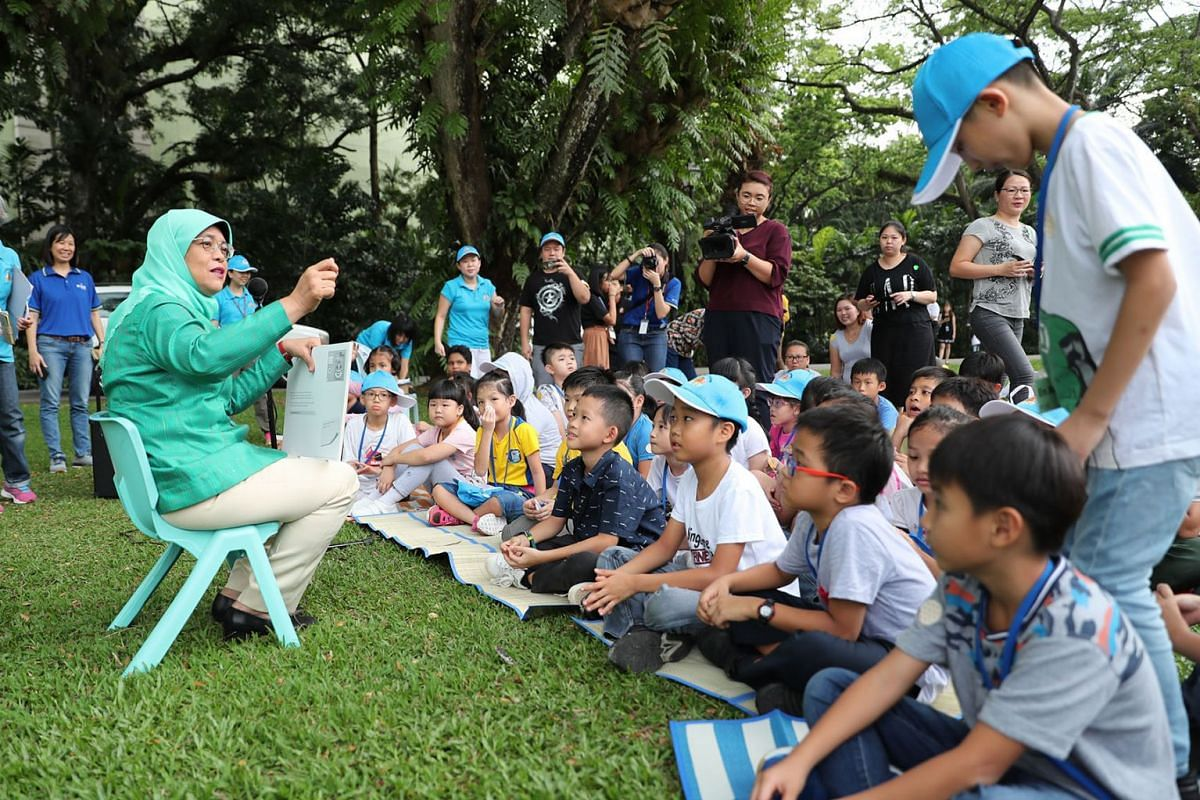 Singapore's President Halimah Yacob has her audience from Shine Children and Youth Services spellbound at the Istana as she read Shrinking Sam to them on April 9, 2019. PHOTO: THE STRAITS TIMES/BENJAMIN SEETOR