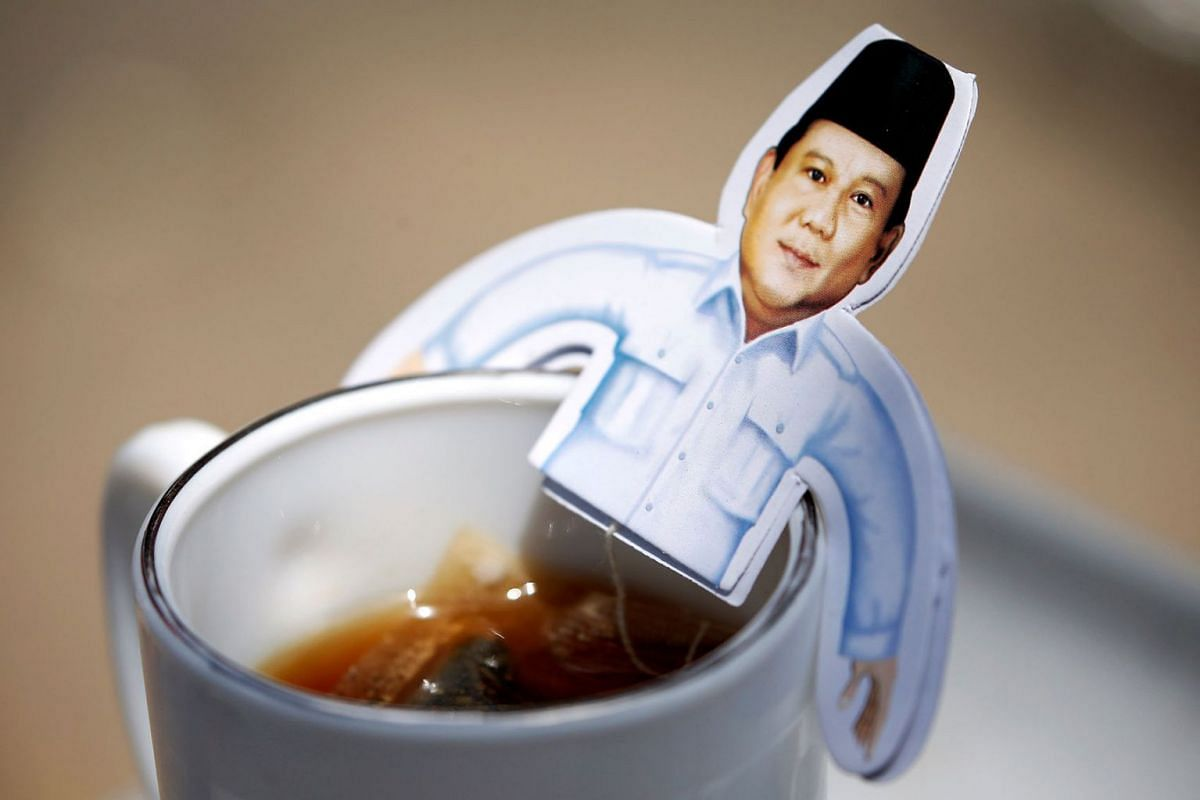 A picture of Indonesia's presidential candidate Prabowo Subianto, who was a former general of the Indonesian military, is seen on a cup during a campaign rally in Solo, Central Java Province, Indonesia, April 10, 2019. PHOTO: REUTERS
