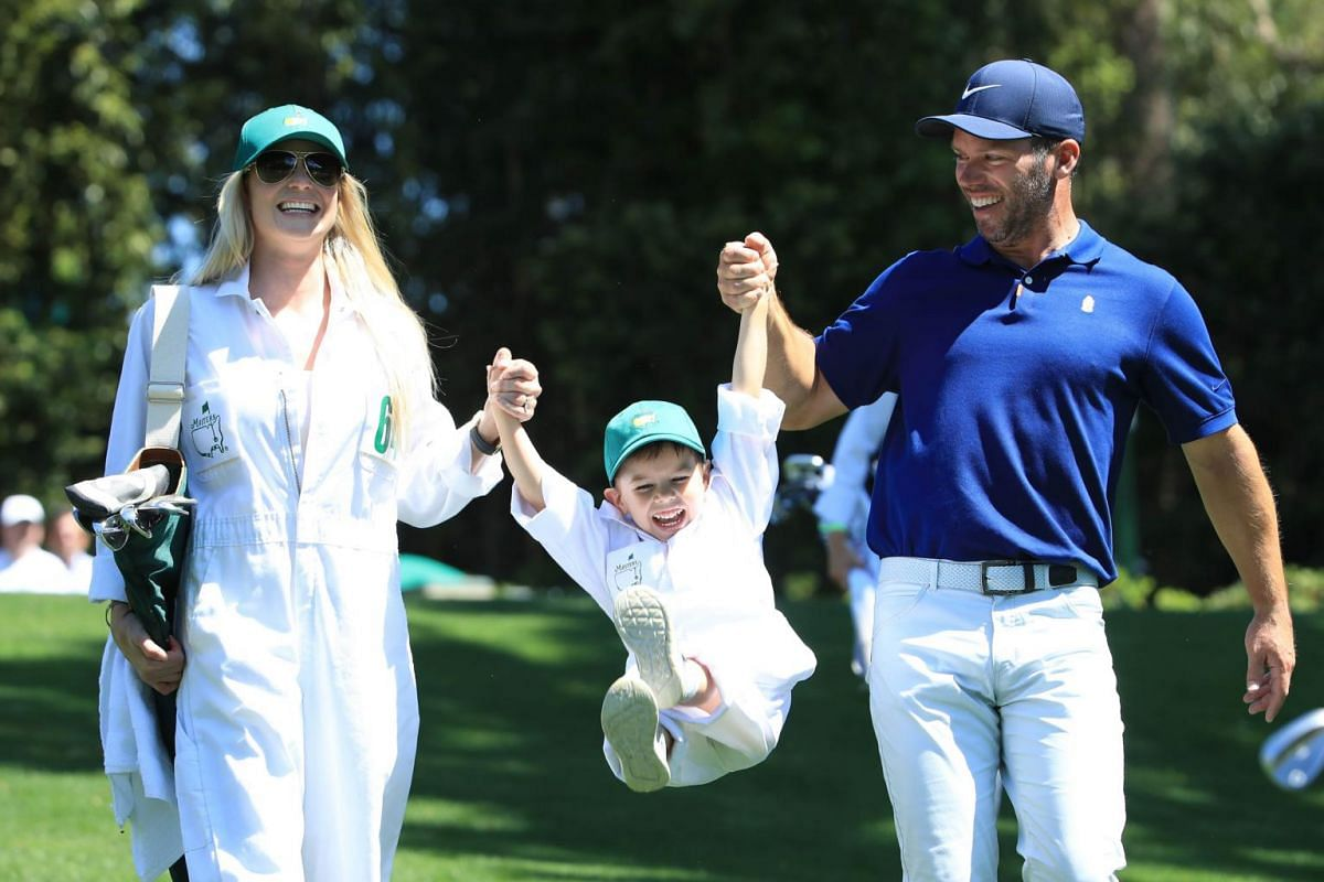 Paul Casey of England walks with his wife Pollyanna and son Lex during the Par 3 Contest prior to the Masters at Augusta National Golf Club in Augusta, on April 10, 2019.
