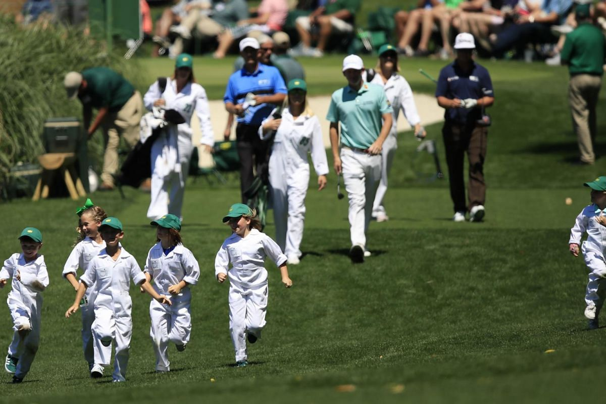 Children run ahead of United States golfers Charles Howell III, Brandt Snedeker and Charley Hoffman on the fifth hole during the Masters Tournament Par 3 Contest at the Augusta National Golf Club in Augusta, on April 10, 2019.