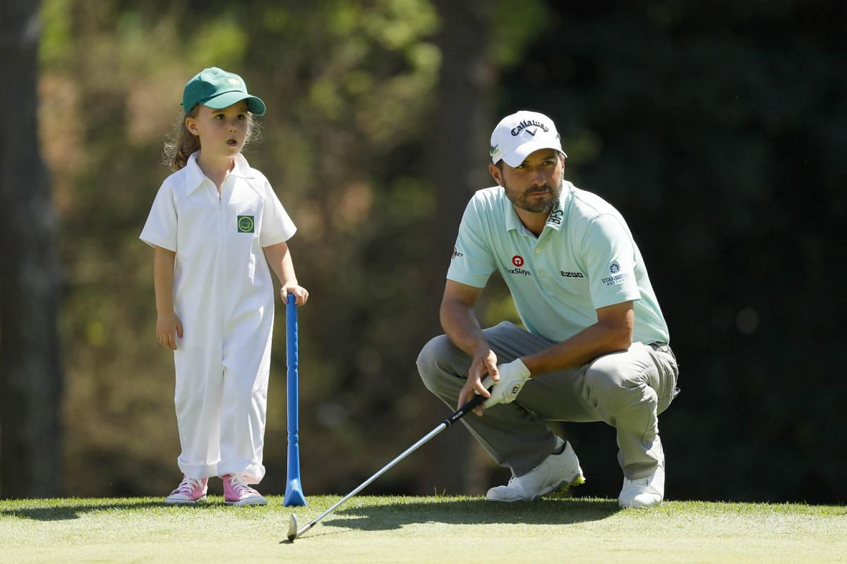 Kevin Kisner of the United States with his daughter Kate during the Par 3 Contest prior to the Masters at Augusta National Golf Club in Augusta, on April 10, 2019.