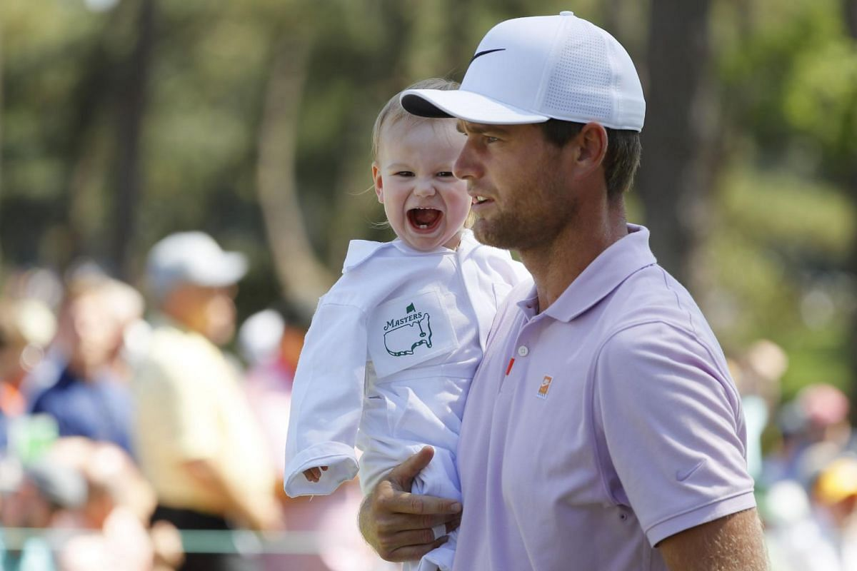 Lucas Bjerregaard of Denmark holds his daughter Josephine during the Par 3 Contest prior to the Masters at Augusta National Golf Club in Augusta, on April 10, 2019.