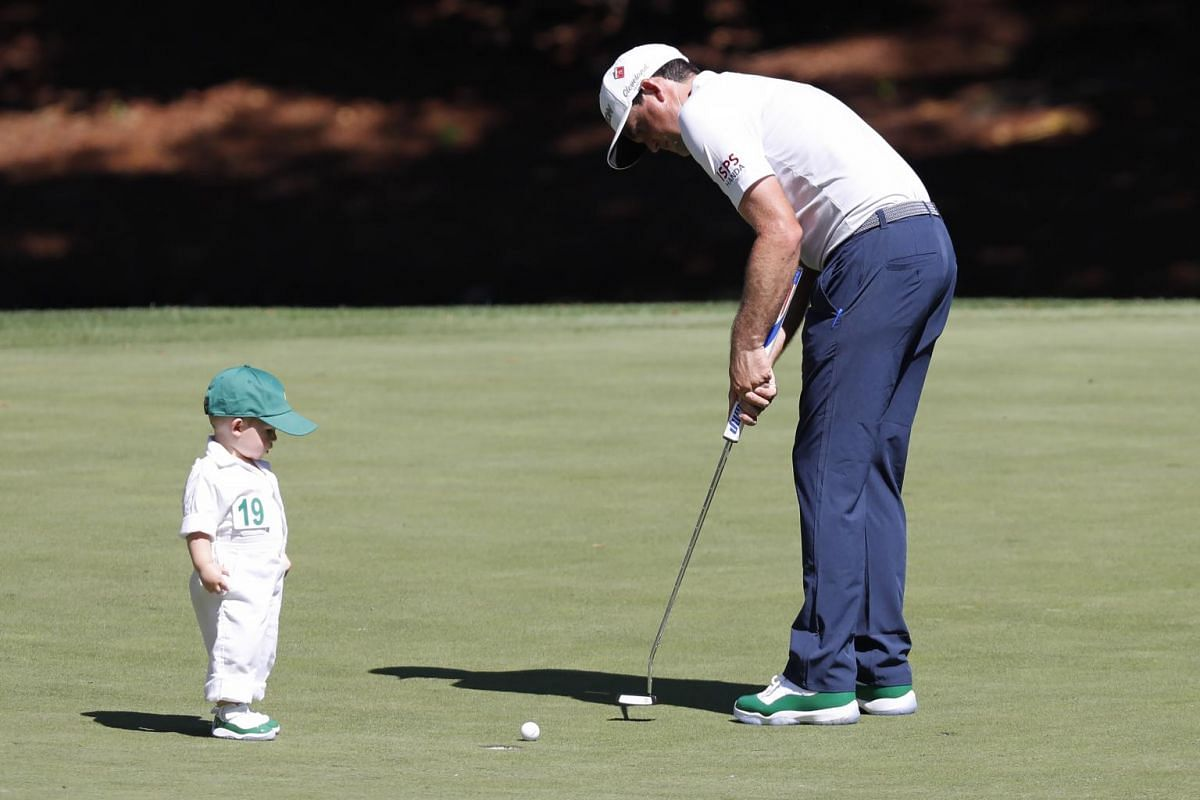 Logan watches his father Keegan Bradley of the United States putt on the eighth hole during the Masters Tournament Par 3 Contest at the Augusta National Golf Club in Augusta, on April 10, 2019.