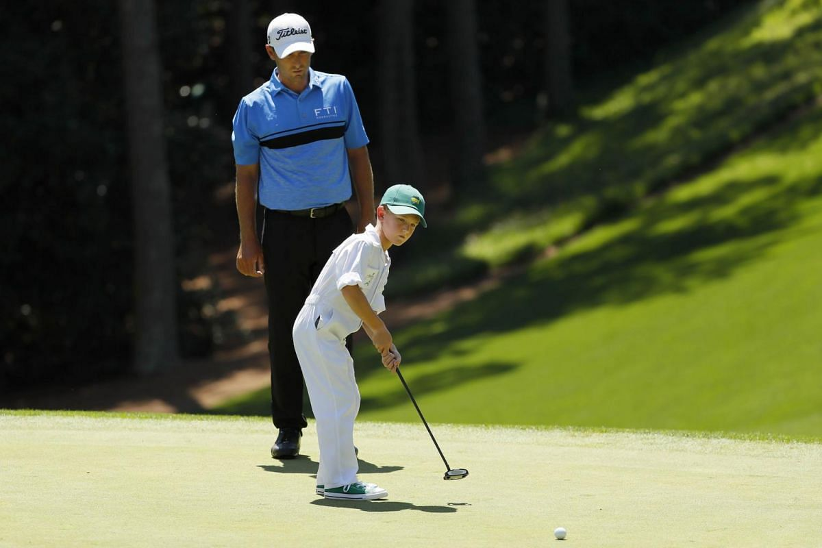 Charles Howell III of the United States watches his son Chase putt during the Par 3 Contest prior to the Masters at Augusta National Golf Club in Augusta, on April 10, 2019.