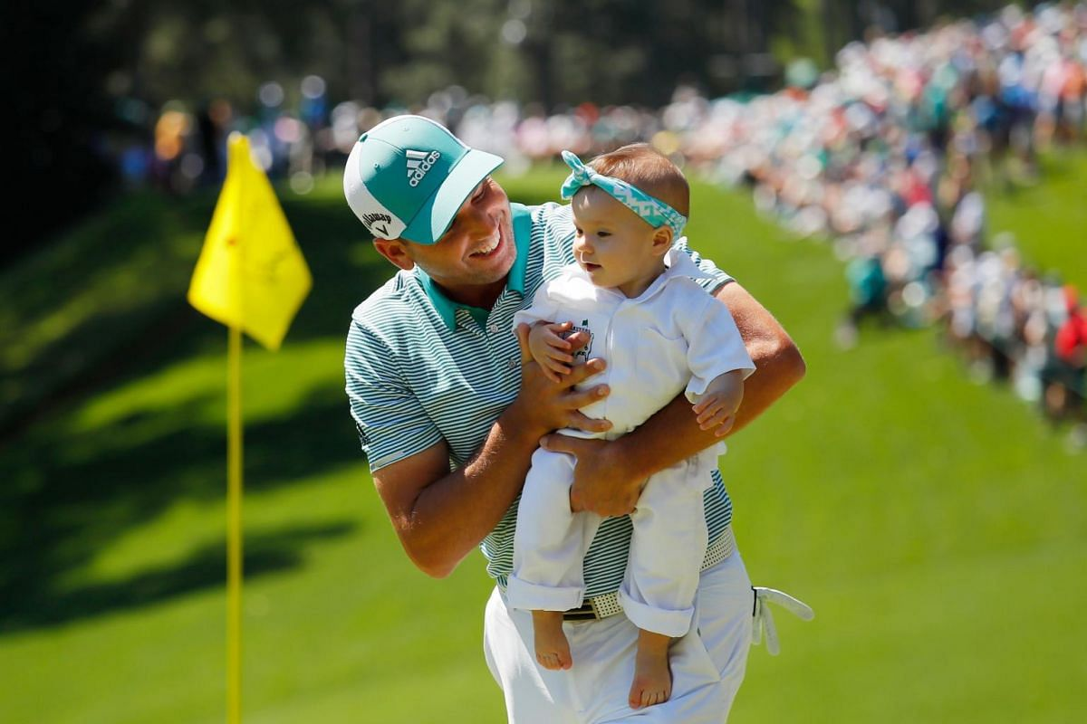 Sergio Garcia of Spain holds his daughter Azalea Adele during the Par 3 Contest prior to the Masters at Augusta National Golf Club in Augusta, on April 10, 2019.