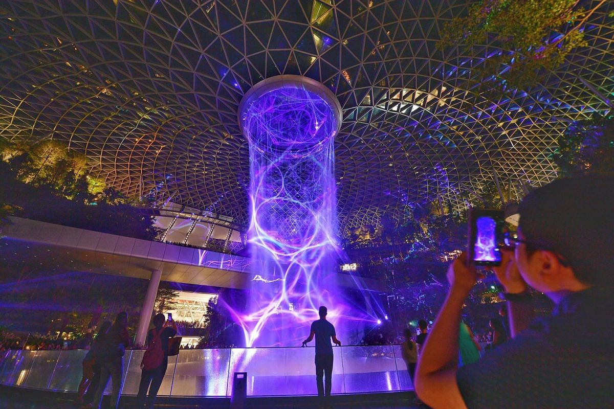 A light and sound show at the HSBC Rain Vortex at Jewel Changi Airport, April 11, 2019. From 1pm on Thursday (April 11) to 10pm next Tuesday, about half a million people who had signed up for free preview tickets are expected to visit. PHOTO: THE STR