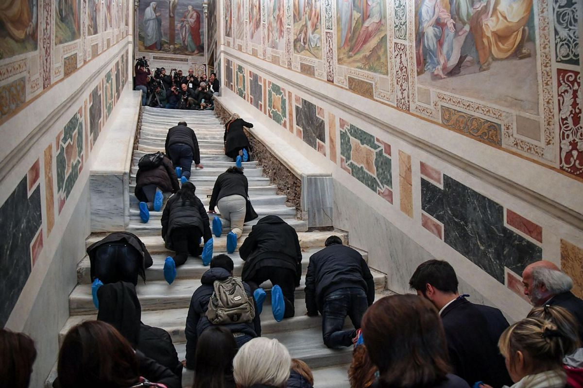 Worshippers attend during the extraordinary opening after the restoration of the Holy Stair (Scala Santa) at San Giovanni in Laterano Dome in Rome, Italy, April 11, 2019. For the Catholic Church the Holy Stair is the stair on which Jesus Christ stepp