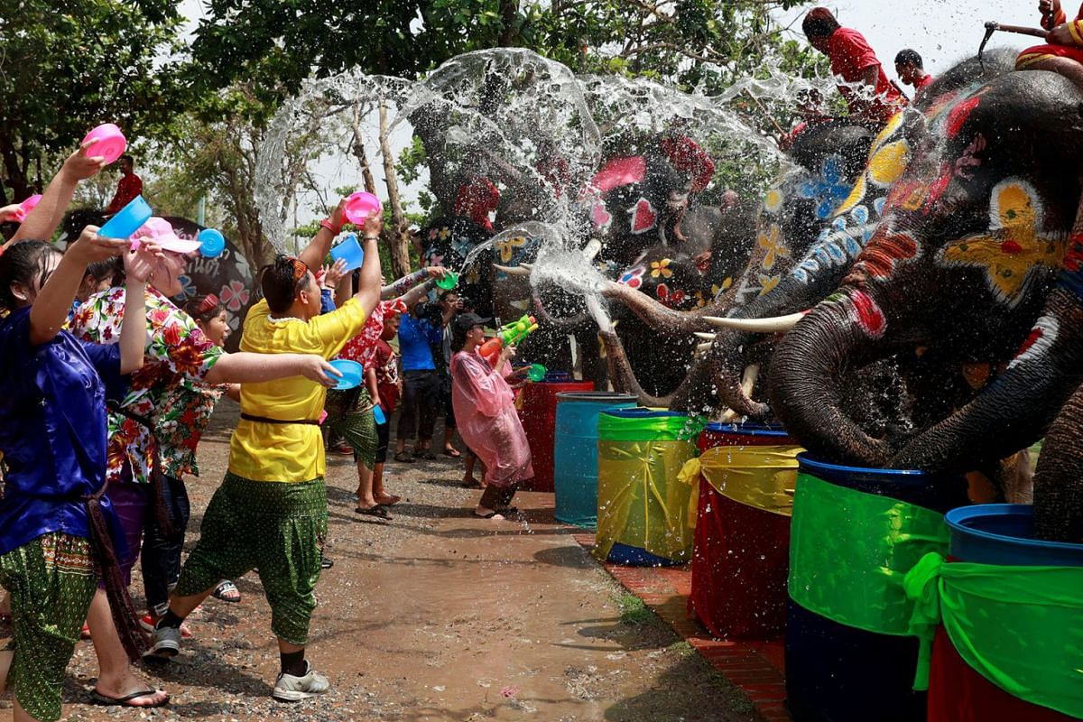 Elephants and people play with water as part of celebrations for the water festival of Songkran, which marks the start of the Thai New Year in Ayutthaya, Thailand April 11, 2019. PHOTO: REUTERS