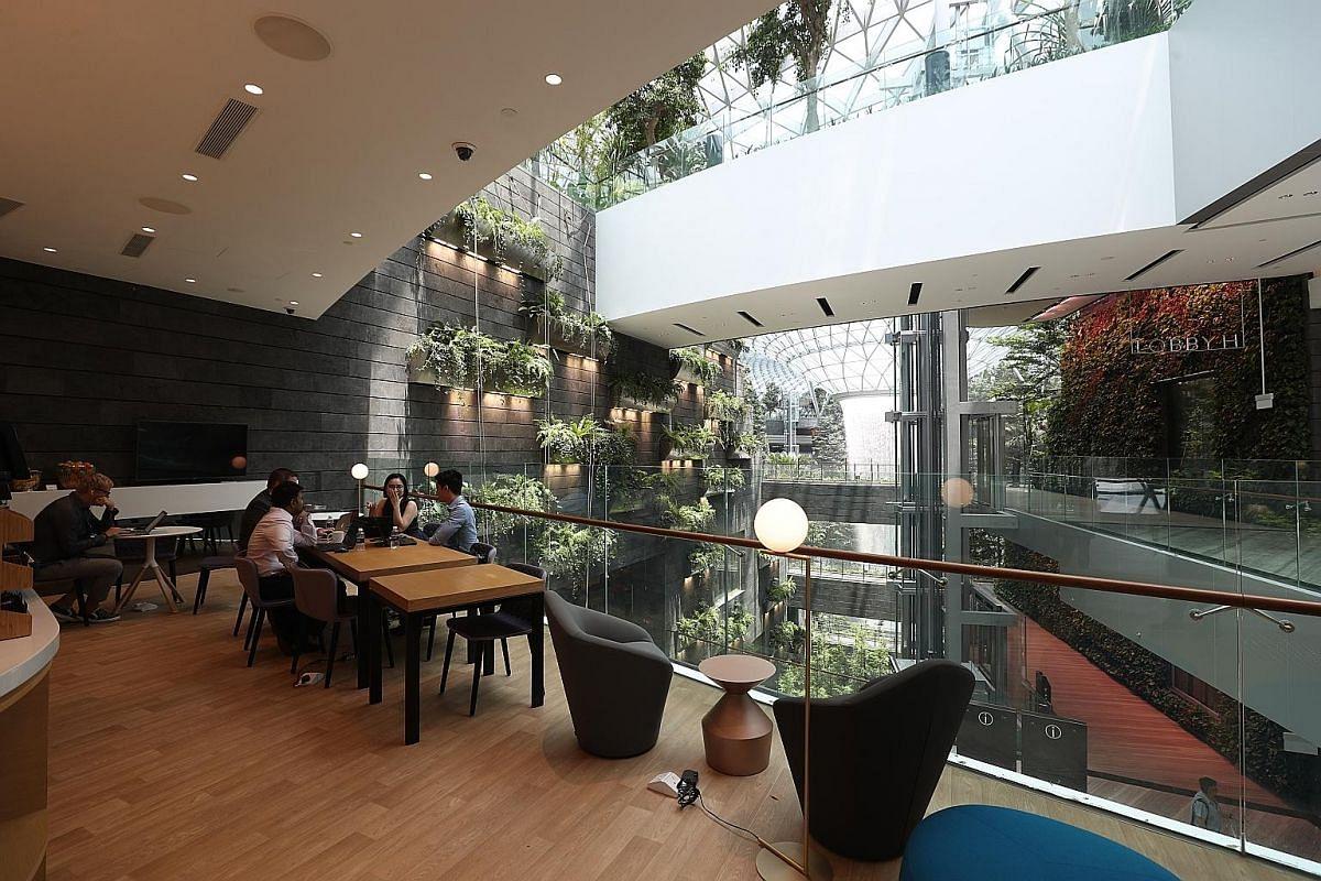 The lounge at Yotelair overlooks the Rain Vortex at Jewel Changi Airport.