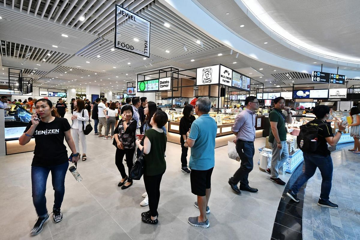 Members of the public walking around the Jewel Food Hall.