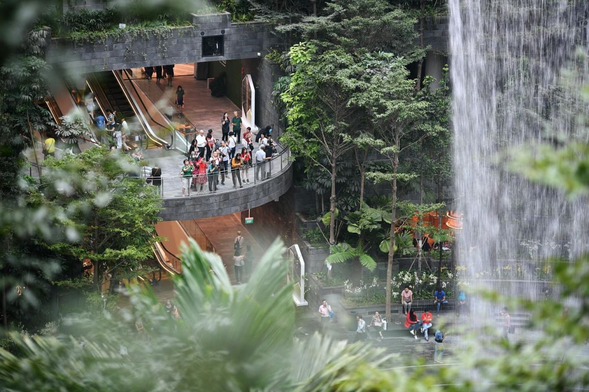 Members of the public view the HSBC Rain Vortex at Jewel Changi Airport.