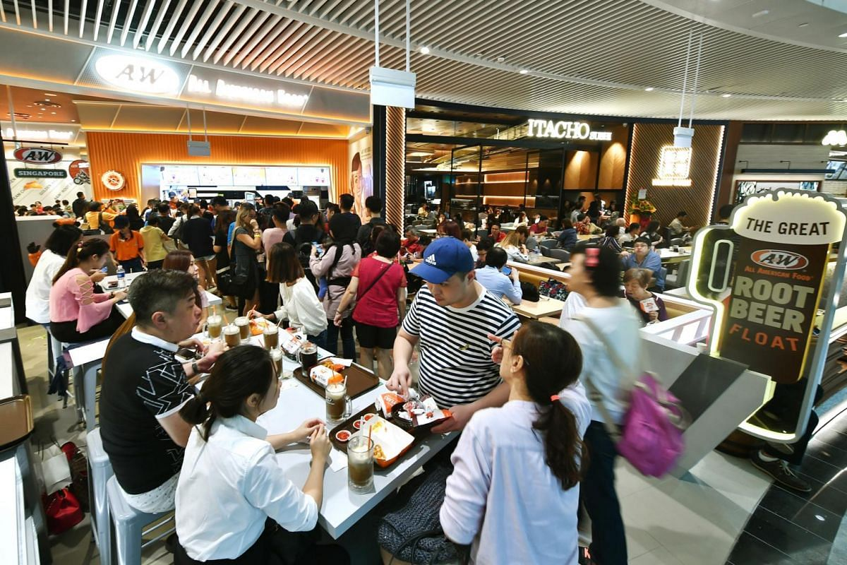 The crowd at American fast-food chain A&W, which is making its comeback in Singapore.