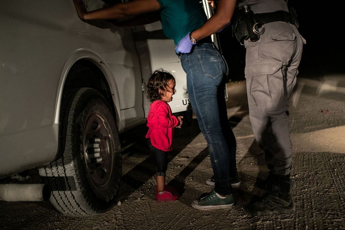 Honduran toddler Yanela Sanchez cries as she and her mother, Sandra Sanchez, are taken into custody by US border officials in McAllen, Texas, on June 12, 2018.