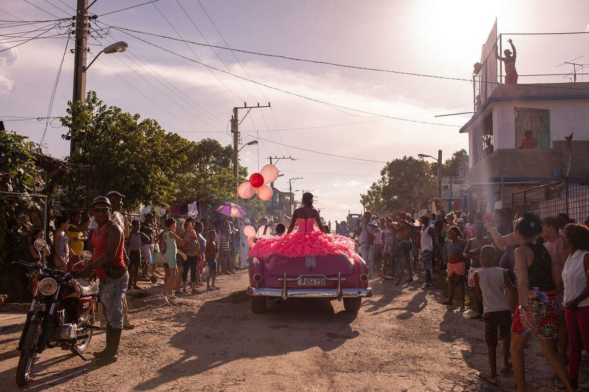 Pura rides around her neighbourhood in Havana in a 1950s convertible, as the community gathers to celebrate her fifteenth birthday.