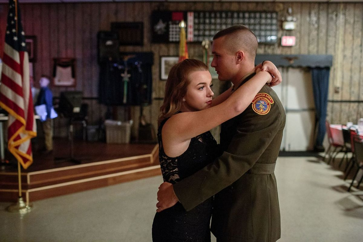 Garett dances with his girlfriend at the Young Marines annual ball, in Hanover, Pennsylvania. Young Marines, a patriotic education programme, has 10,000 students nationwide and focuses on youth development in areas such as citizenship, patriotism and