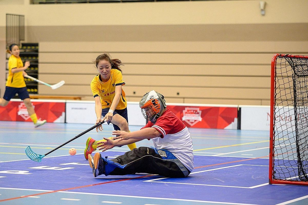 Joan Hia of Team U Sports Litto FC trying to score past Team Tempest goalkeeper Neo Chien Jun in their ActiveSG-SFA Floorball Premier League opener at Our Tampines Hub yesterday. Team U Sports Litto won 10-0. The first round of the league, which feat
