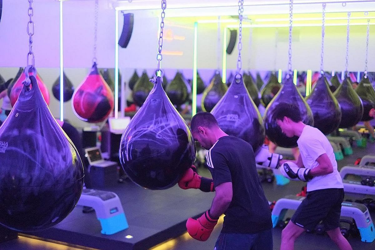 Vary workouts to sustain interest with exercises such as HIIT-inspired boxing at boOm Singapore.
