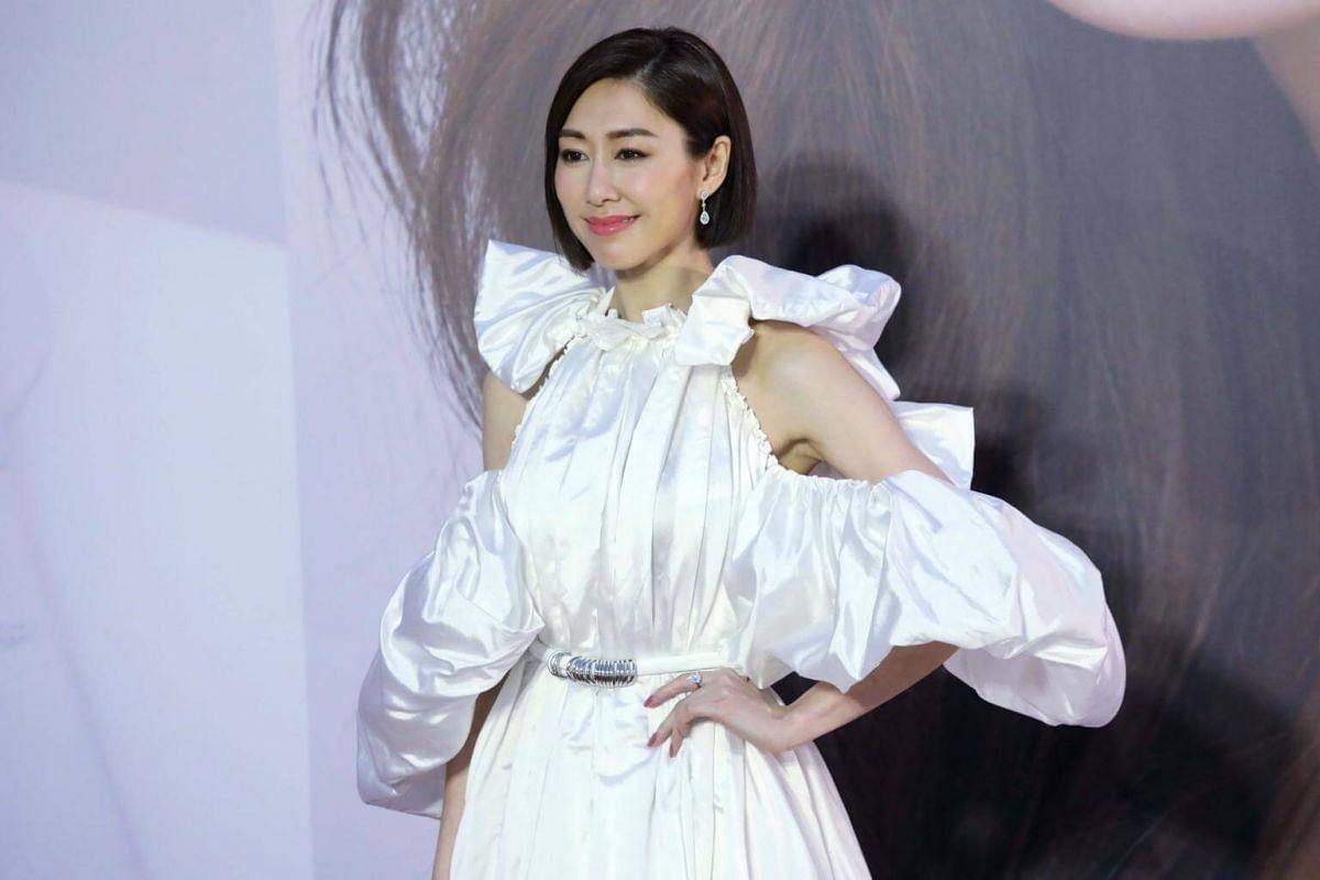 Actress Nancy Wu poses for photos at the 38th Hong Kong Film Awards.