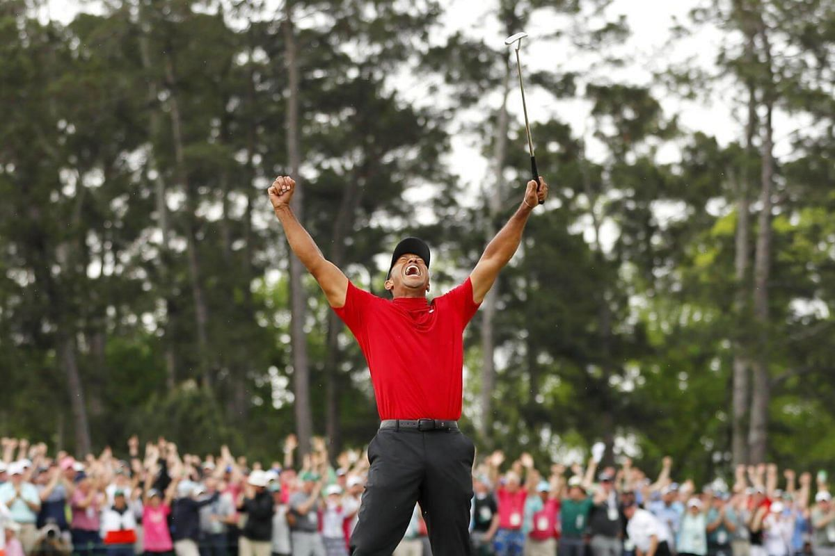 Tiger Woods celebrates after sinking his putt on the 18th green to win the 2019 Masters.