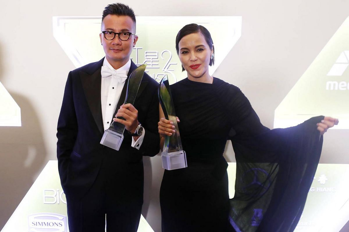 Best Actor and Best Actress winners Chen Hanwei and Zoe Tay.