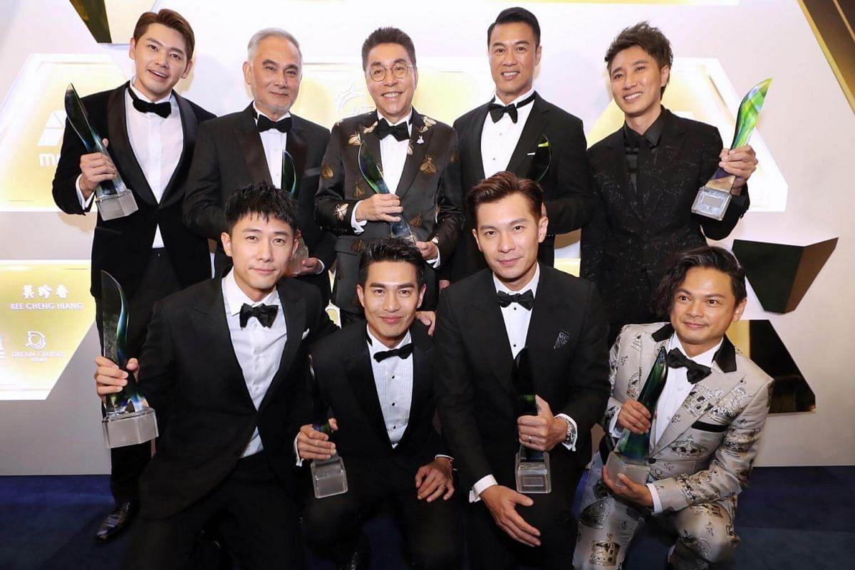 Some of the Top 10 Male Artiste winners pose for pictures after the show: (back row, from left) Romeo Tan, Zhu Houren, Chen Shucheng, Zheng Geping, Dasmond Koh, (front row, from left) Desmond Tan, Pierre Png, Shaun Chen and Dennis Chew.