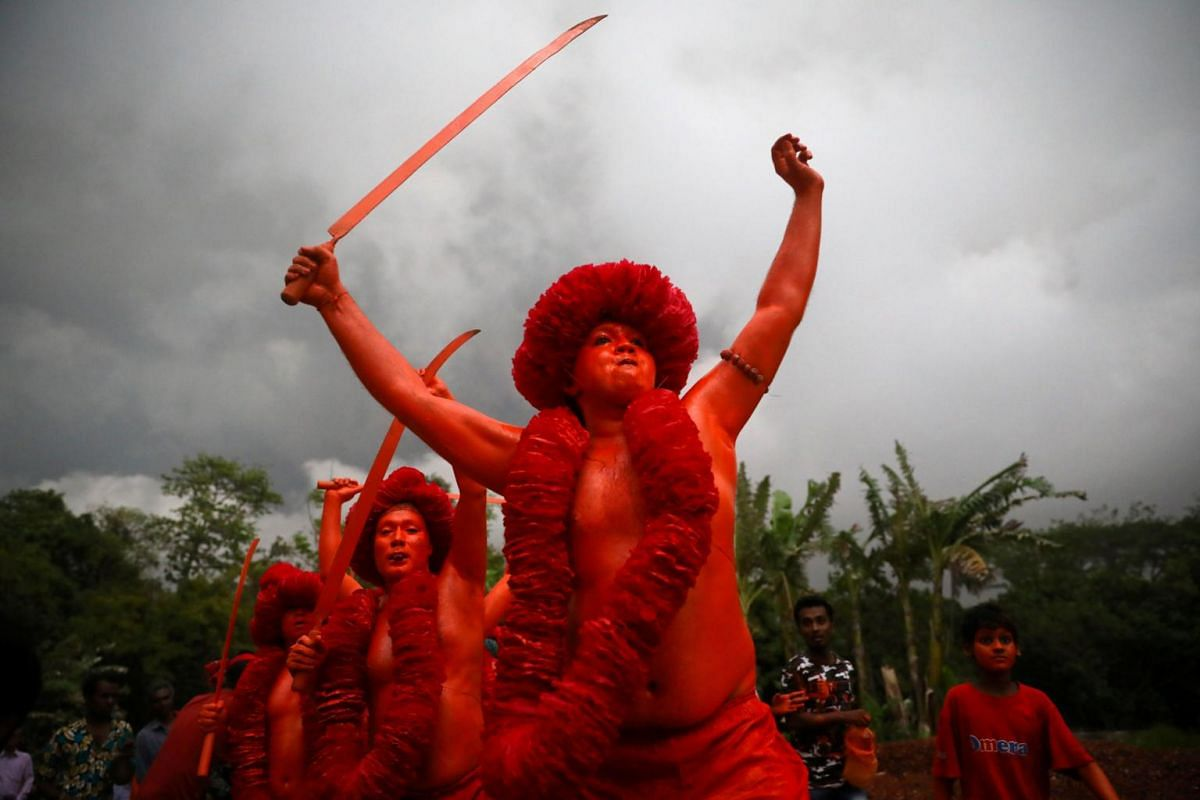 Hindu devotees join a rally after applying colour on their body as they celebrate Lal Kach festival in Munshiganj, Bangladesh, on April 13, 2019.