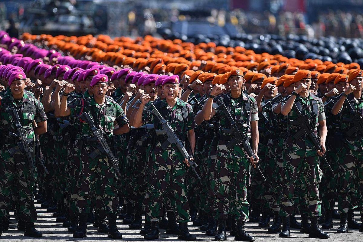 Incumbent President Joko Widodo at his final rally in Jakarta on Saturday. The rematch between him and Mr Prabowo Subianto tomorrow is expected to be an even closer fight than in 2014. Indonesian soldiers at a general security roll call in Jakarta on