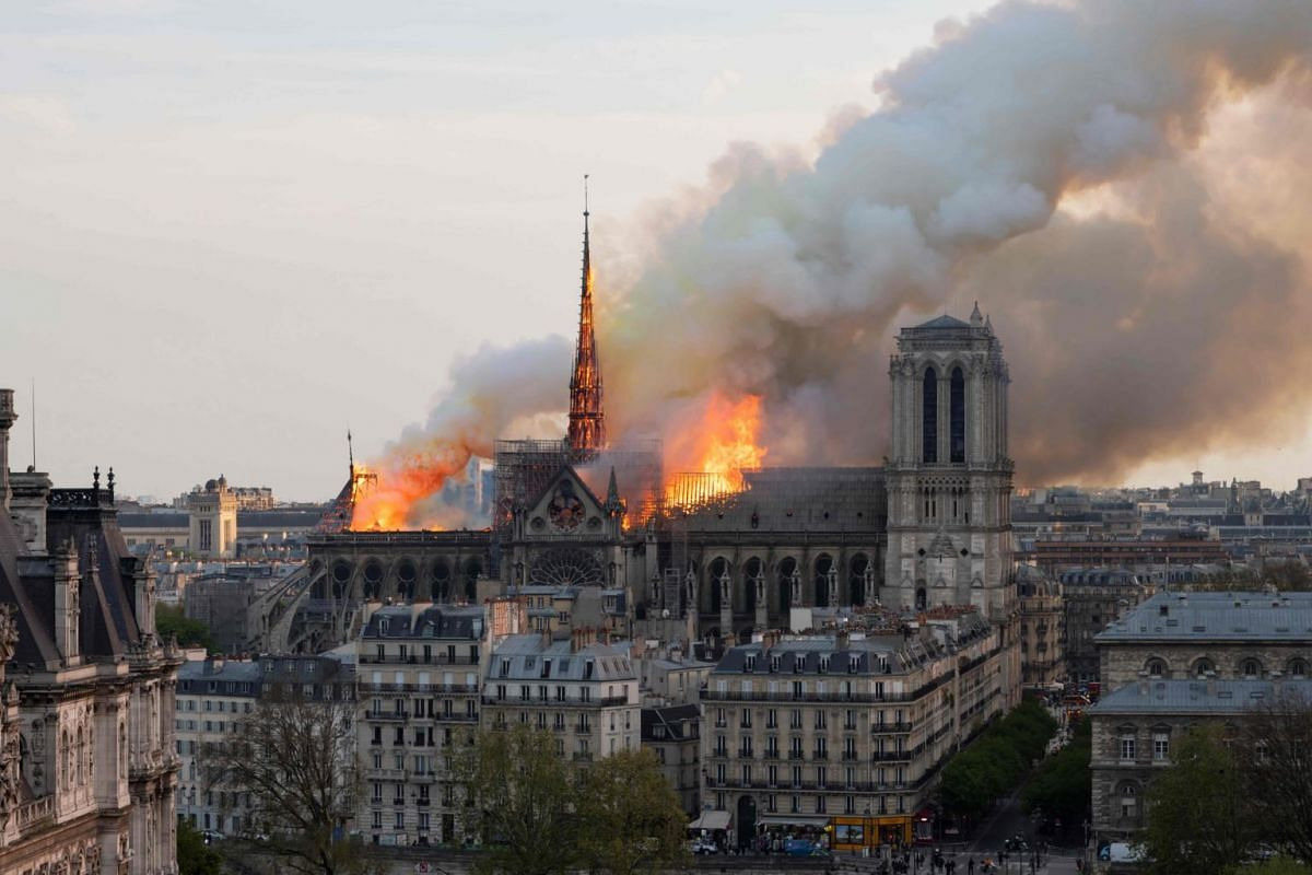 Smoke billows as flames burn through the roof of the Notre Dame Cathedral, on April 15, 2019. A huge plume of smoke wafted across Paris and ash fell over a large area.
